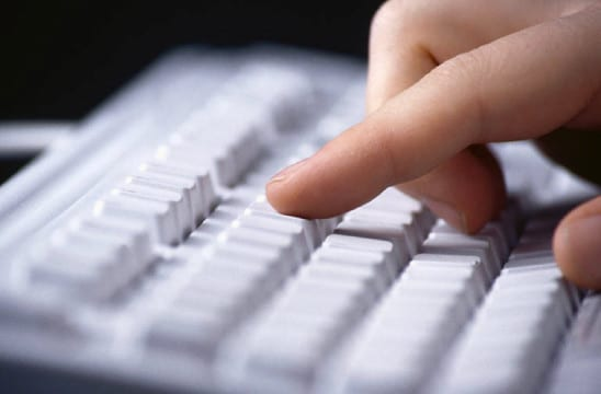 hands typing on key board