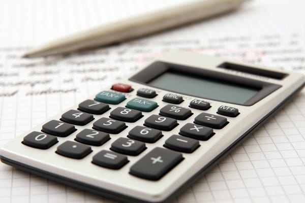 Get Financially Fit for a More Productive Life - Part 2: white and black desk calculator on white graphing paper