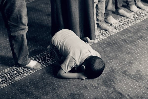 How to drag your feet to prayer when you feel not praying - in the image, a child in sujood